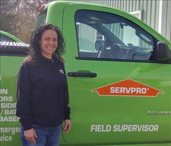 SERVPRO of Jersey City shares picture of one of their female project managers standing in front of a work vehicle.
