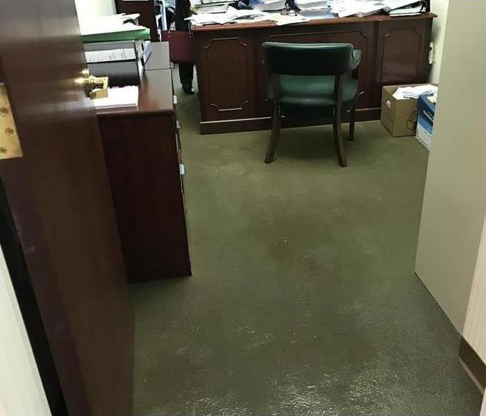 water on the carpet of an office
